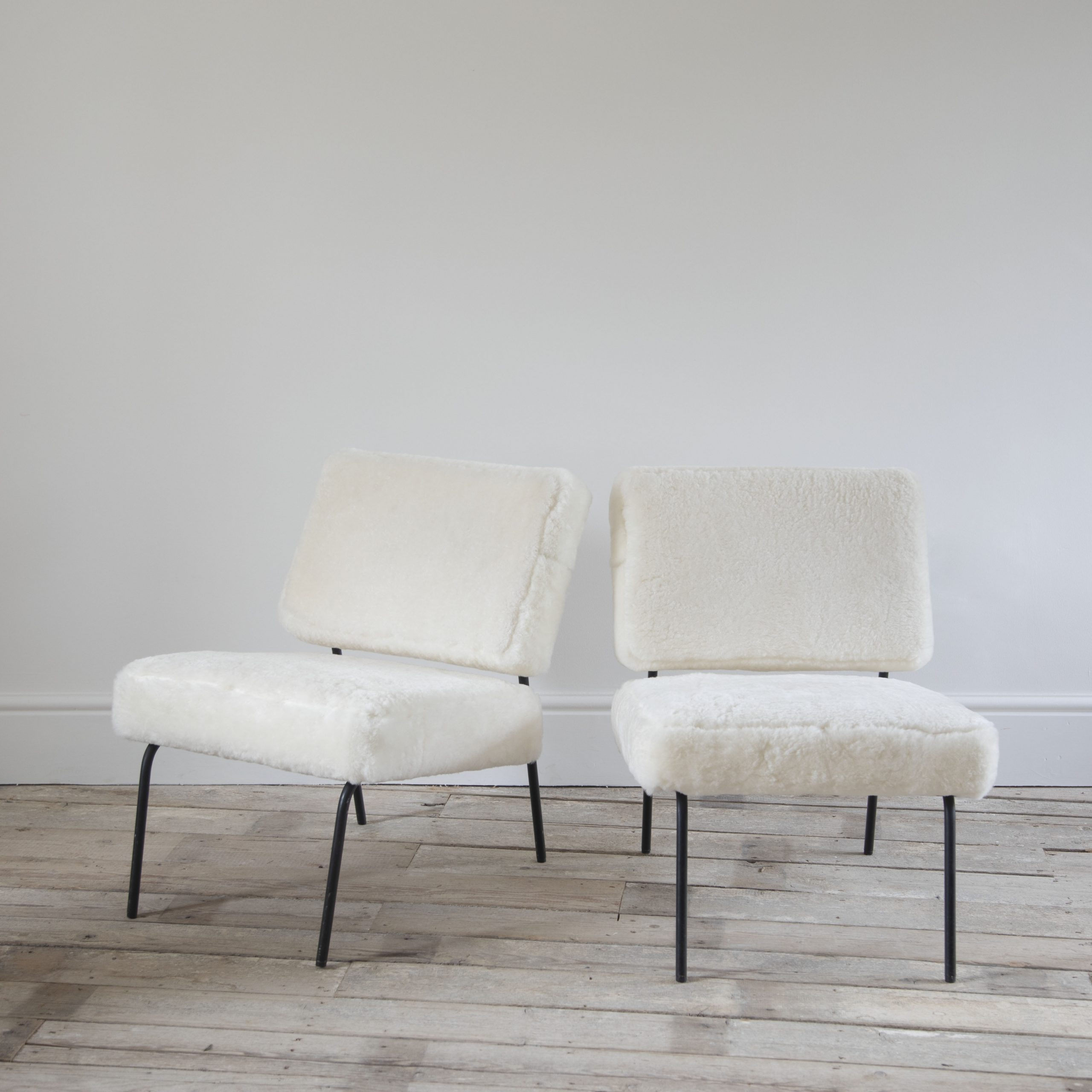Pair of Pierre Guariche Airborne Edition Chairs